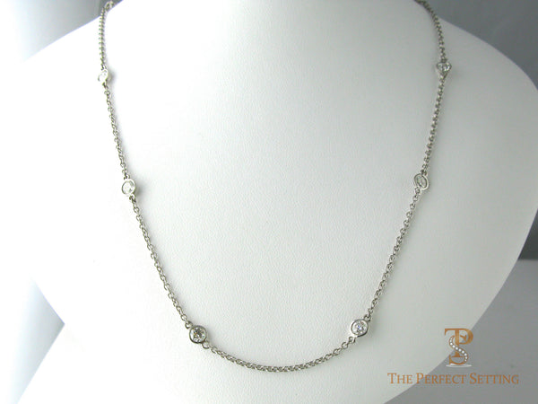 Diamonds bezel set on Platinum Chain