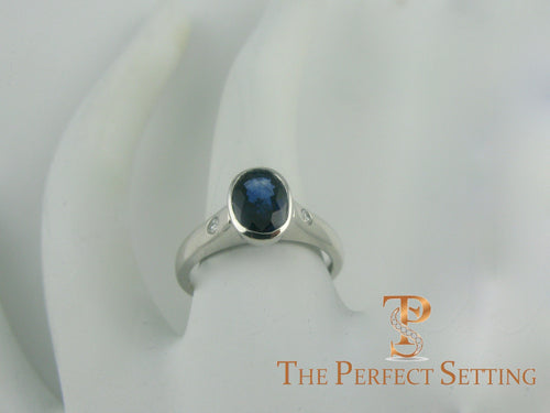 Bezel Set Oval Sapphire and Diamond Ring