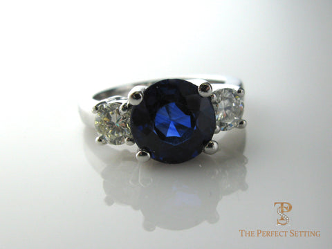 Three Stone ring Sapphire with two diamonds