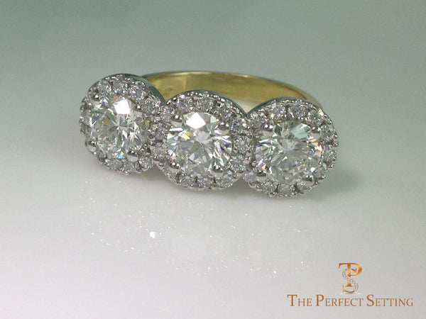 three stone diamond halo ring on side
