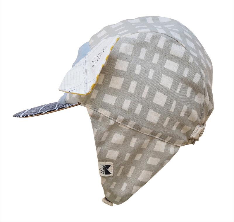 trendy kids sun hat with five panels, pleated animal ears, a blue front patch, taupe and white print.and contrasting peak