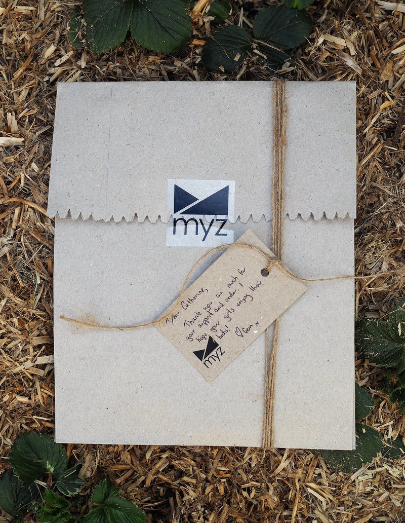 myz childrens hat wrapping in 100% post consumer recycled paper and jute string