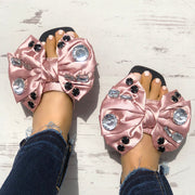 Exaggerated Bowknot Shiny Decorated Flat Sandals - Shop Shiningbabe - Womens Fashion Online Shopping Offering Huge Discounts on Shoes - Heels, Sandals, Boots, Slippers; Clothing - Tops, Dresses, Jumpsuits, and More.