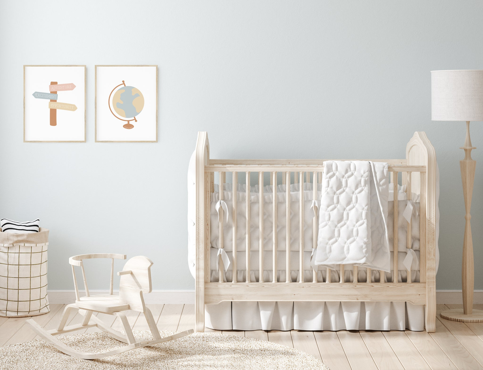Nursery with blue wall, light wood furniture and travel art