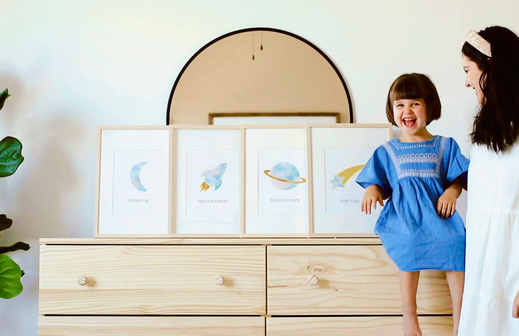 Space themed art prints with little girl laughing