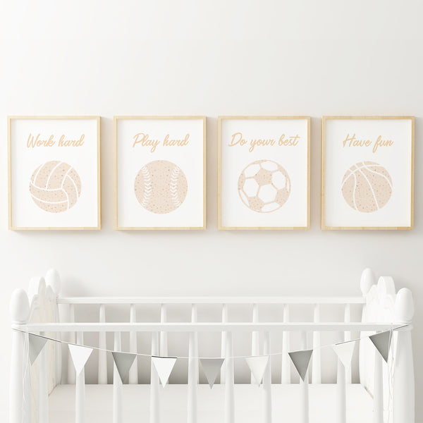 Four 8x10 sports prints for girls above crib in sports-themed nursery.