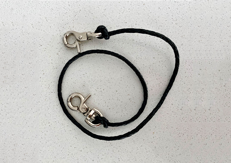 Mask strap with black woven leather