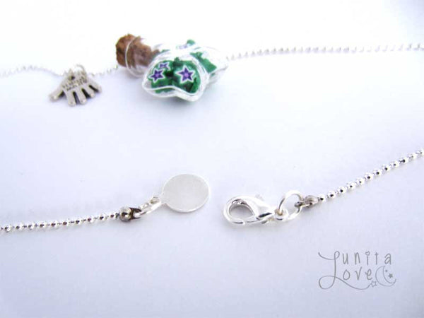 Handmade miniature bottle charm with stars