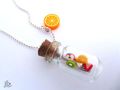 Mini Glass Bottle filled with tiny slices of fruits handmade into a necklace with orange pendant.