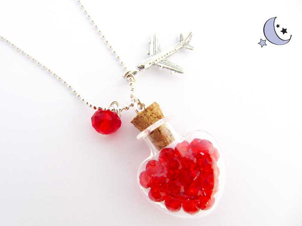 Heart shaped mini glass bottle pendant. Red rhinestones. Airplane charm