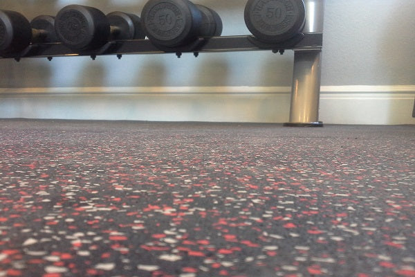 Workout Dumbells on a rubber gym floor