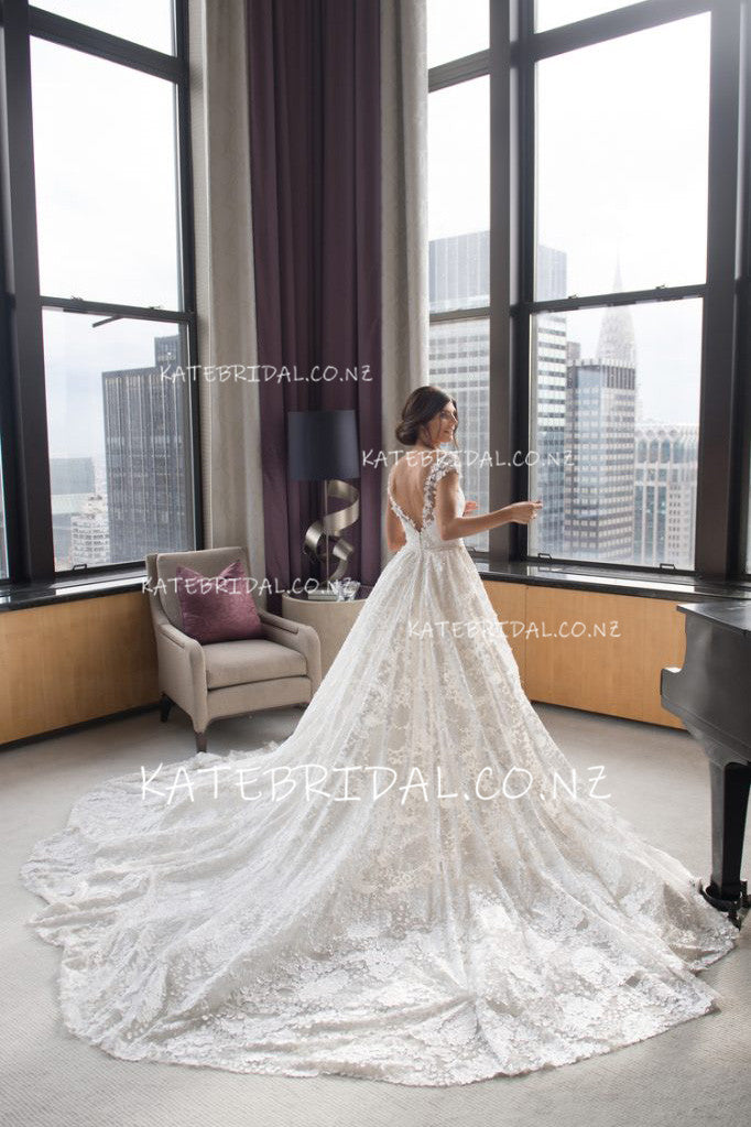 Appliqued Open Back Cap Sleeve Cathedral Bridal Dress With Overskirt