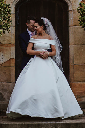 Plain Off-The-Shoulder Satin Ball Gown Wedding Dress With Bowknot Back Detail