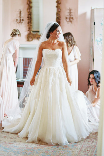 A-Line Ivory Chiffon Strapless Sweep Train Wedding Dress With Lace Bodice