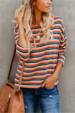 A Long Sleeved T-Shirt With Rainbow Stripes