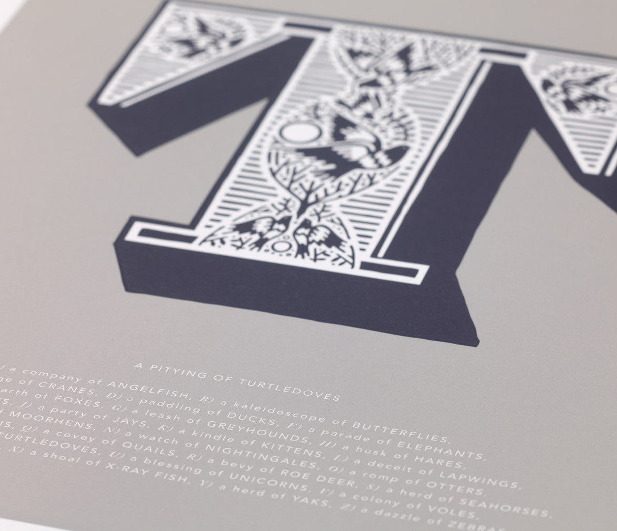 Close up of Illustrated Letter T in putty grey