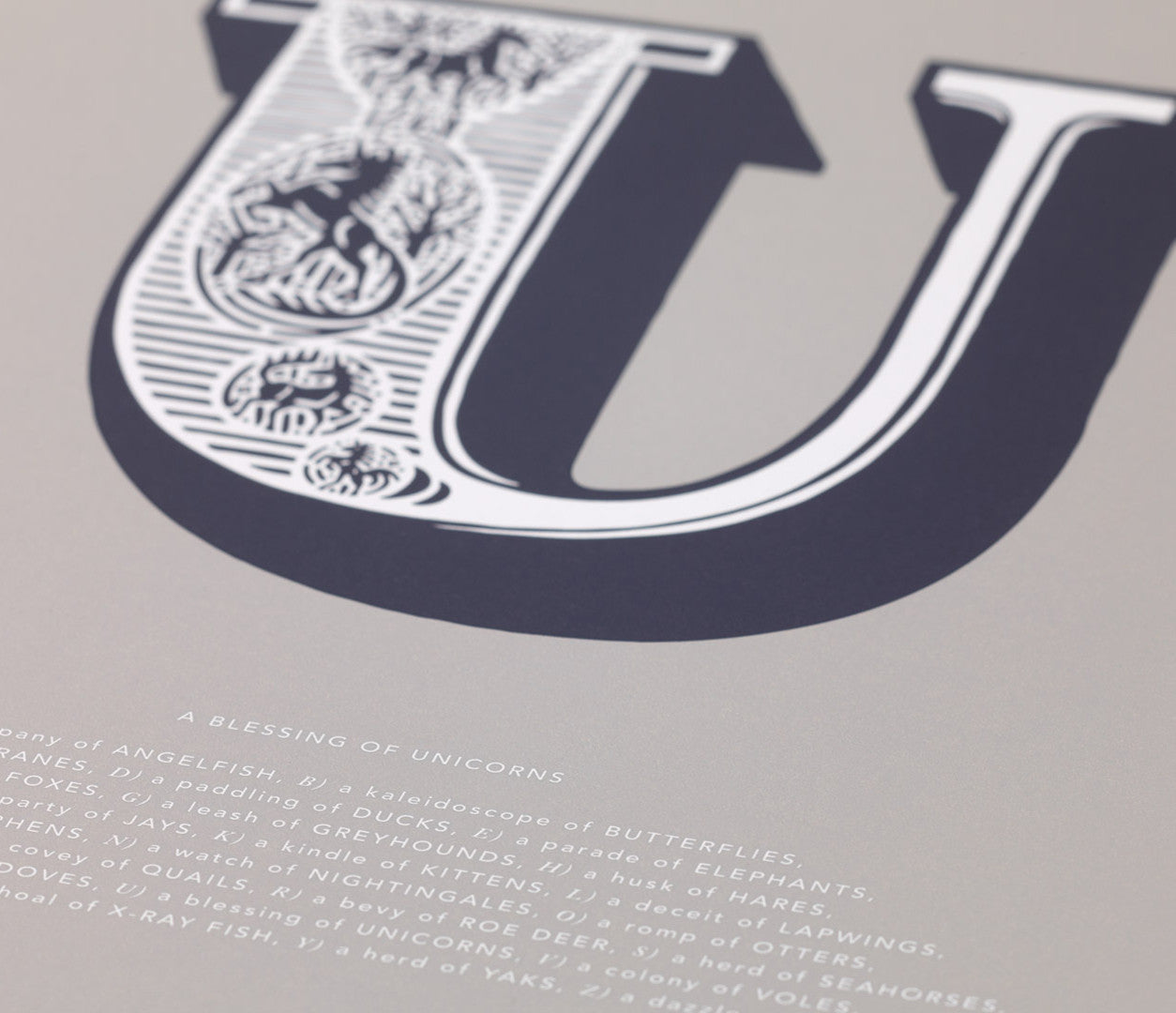 Close up of Illustrated Letter U in putty grey