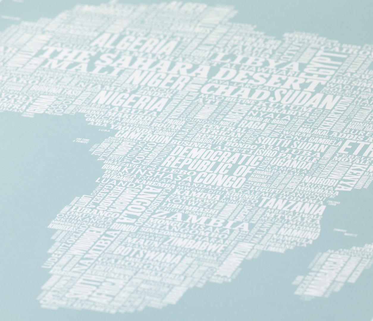 Close up of Africa Type Map screen print in duck egg blue