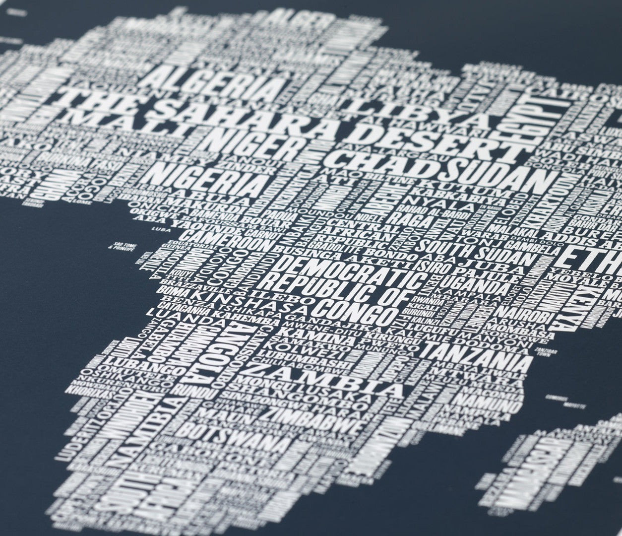 Close up of Africa Type Map screen print in sheer slate