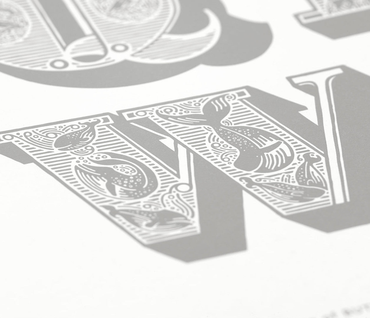 Close up of illustrated A-Z screen print wall art in putty grey