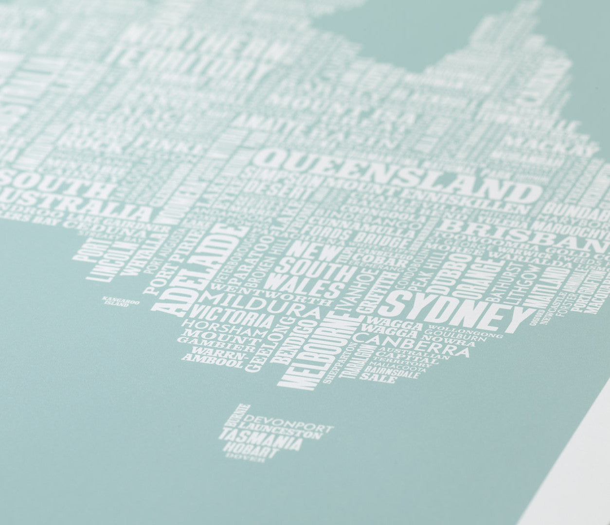 Close up of Australia Type Map screen print in duck egg blue