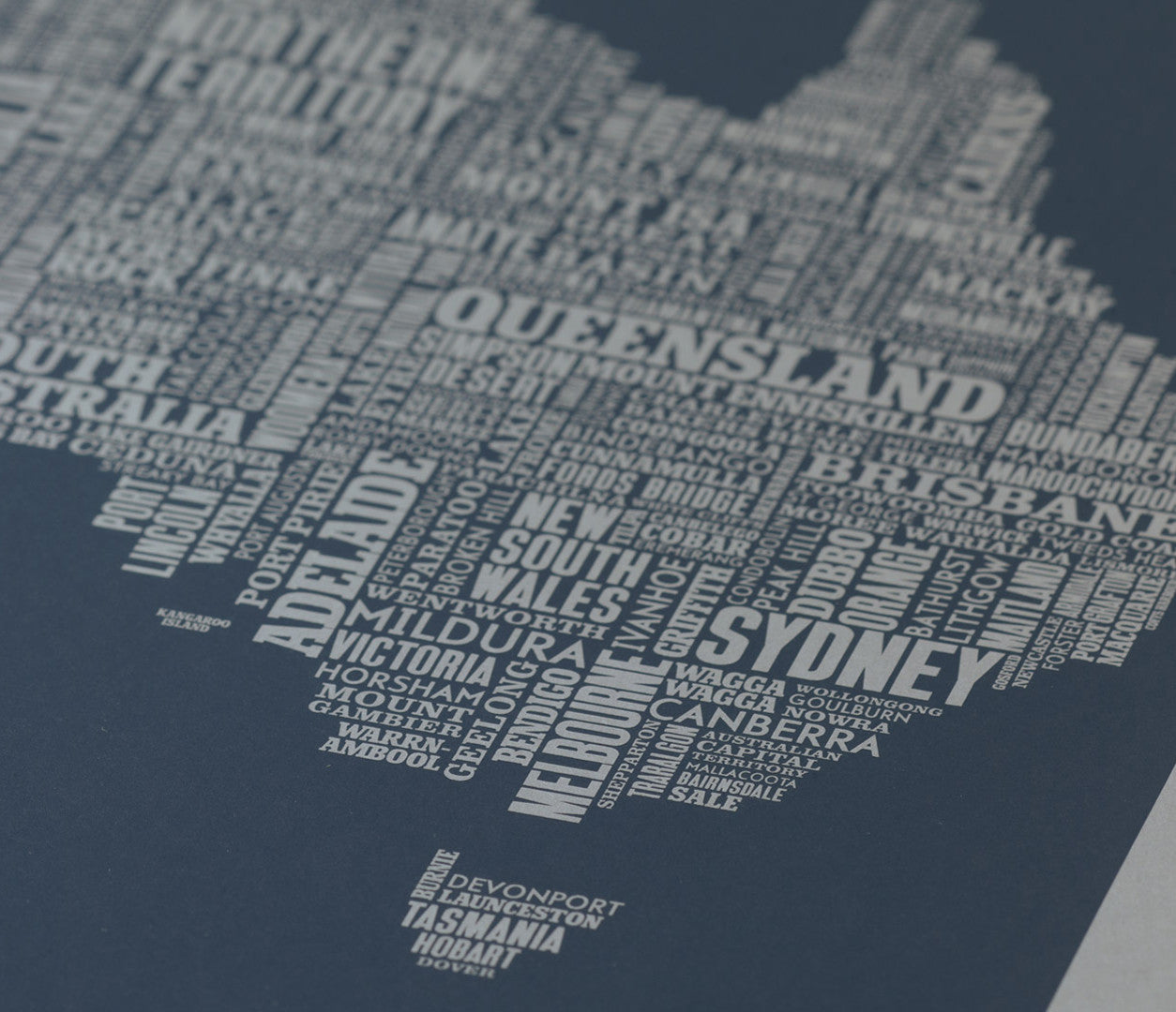 Close up of Australia Type Map limited edition screen print in sheer slate on grey card