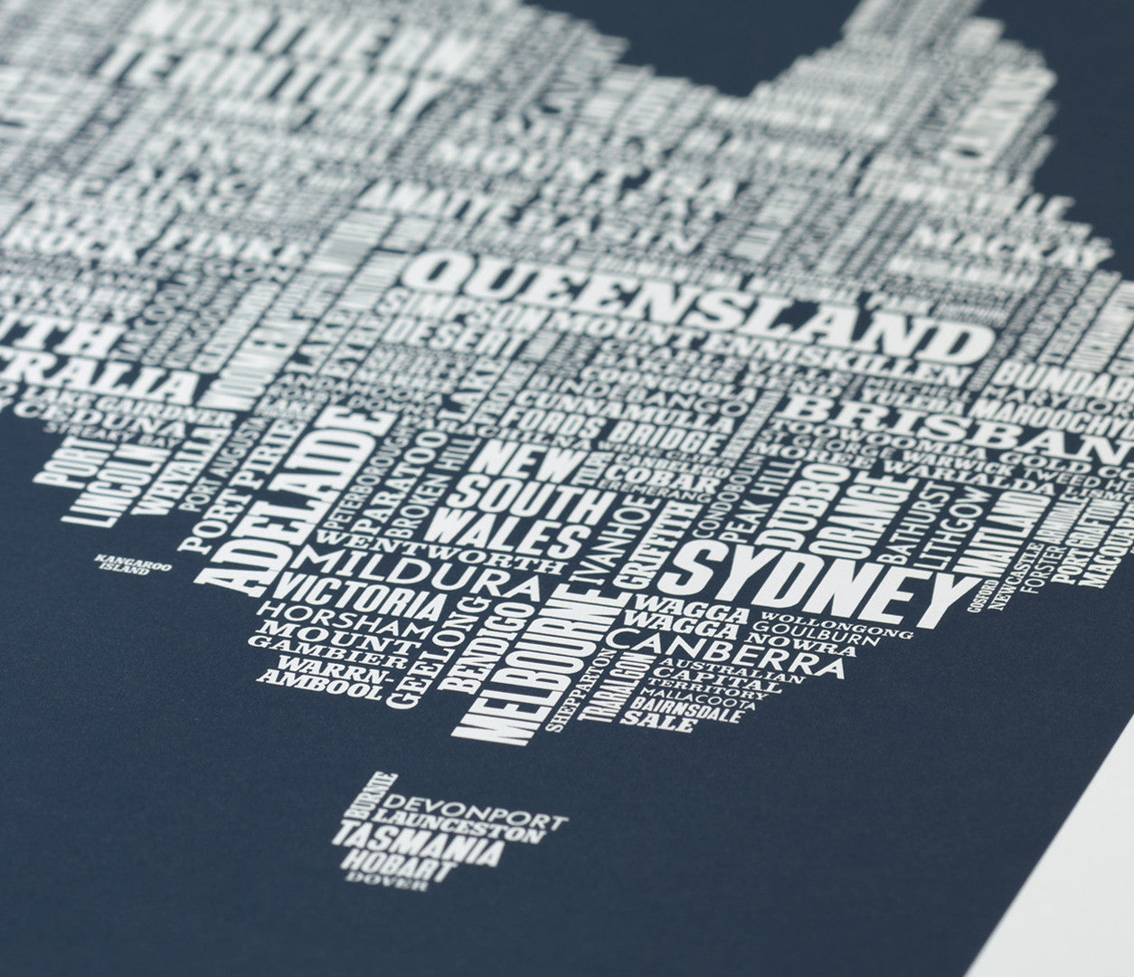 Close up of Australia Type Map screen print in sheer slate