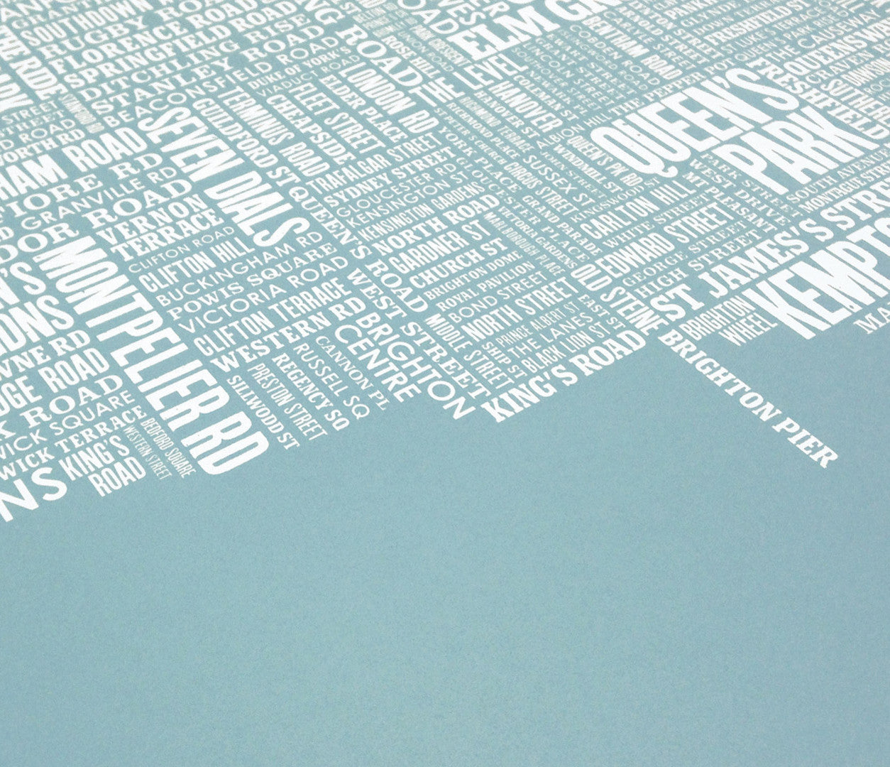 Close up of Brighton Type Map screen print in coastal blue