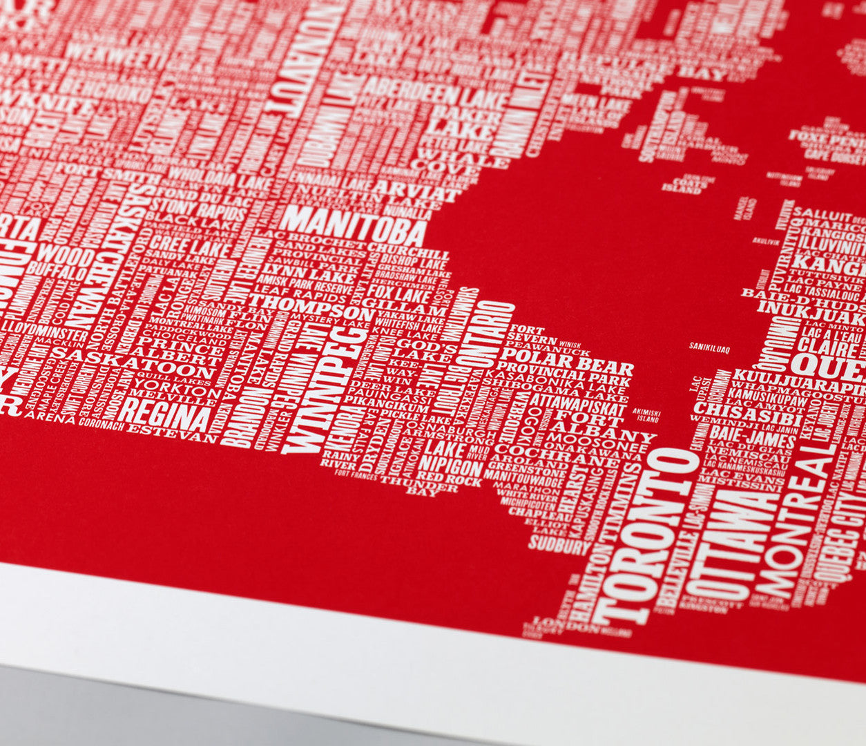 Close up of Canada Type Map screen print in poppy red