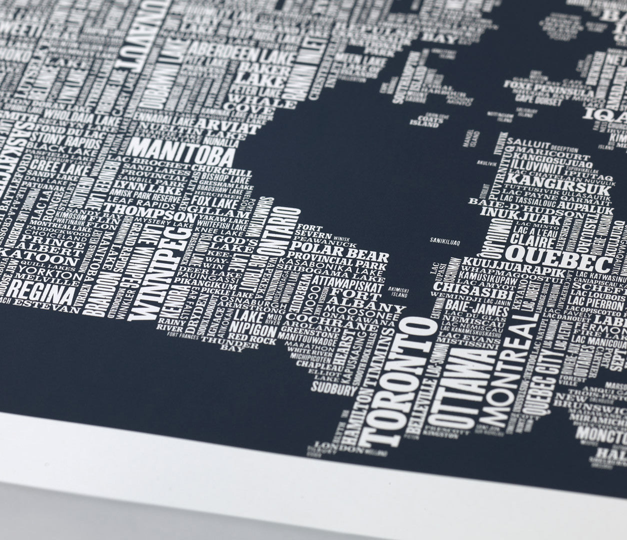 Close up of Canada Type Map screen print in sheer slate