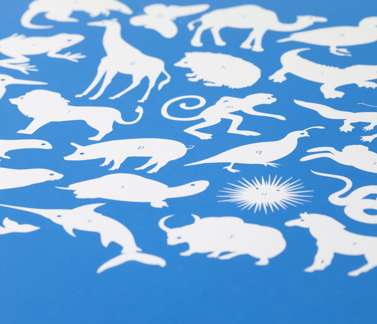 Close up of Creatures A-Z screen print in cobalt blue, economical kids wall art ideas