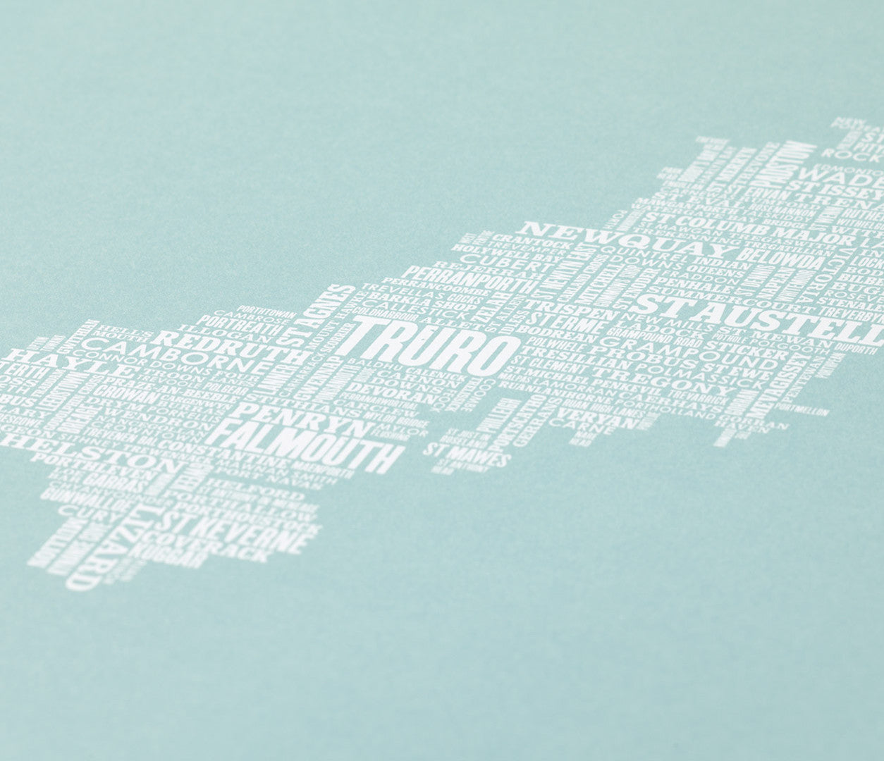Close up of Cornwall Type Map screen print in duck egg blue