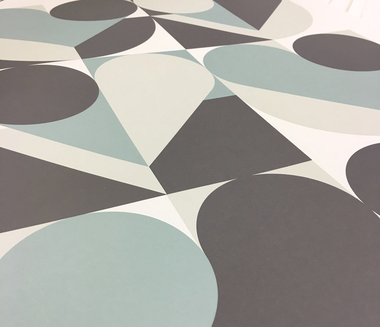 Close up of Geometric Heart screen printed poster in duck egg blue and grey