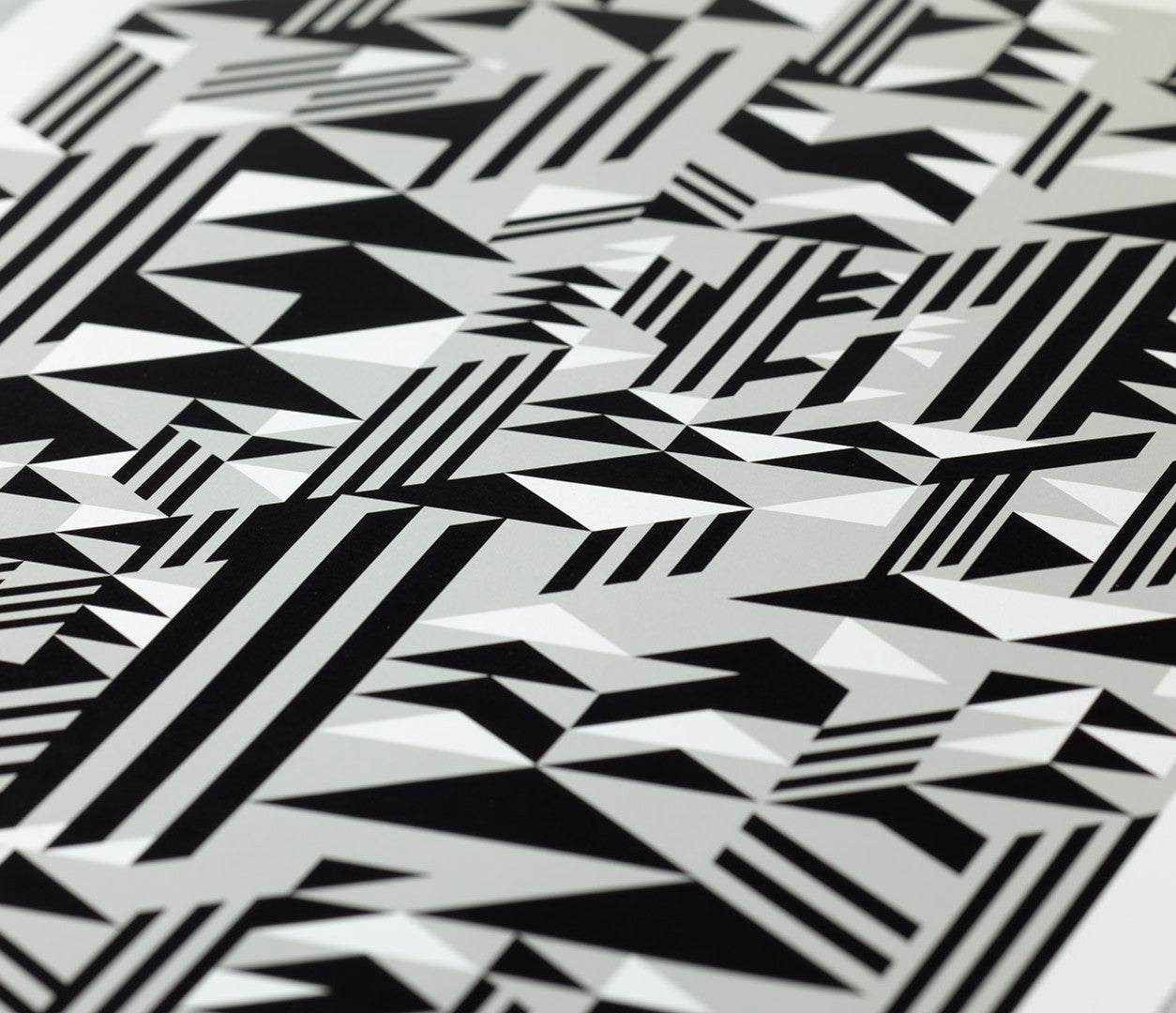 Close up of Geometric Higher Print in Black and Grey, screen printed poster