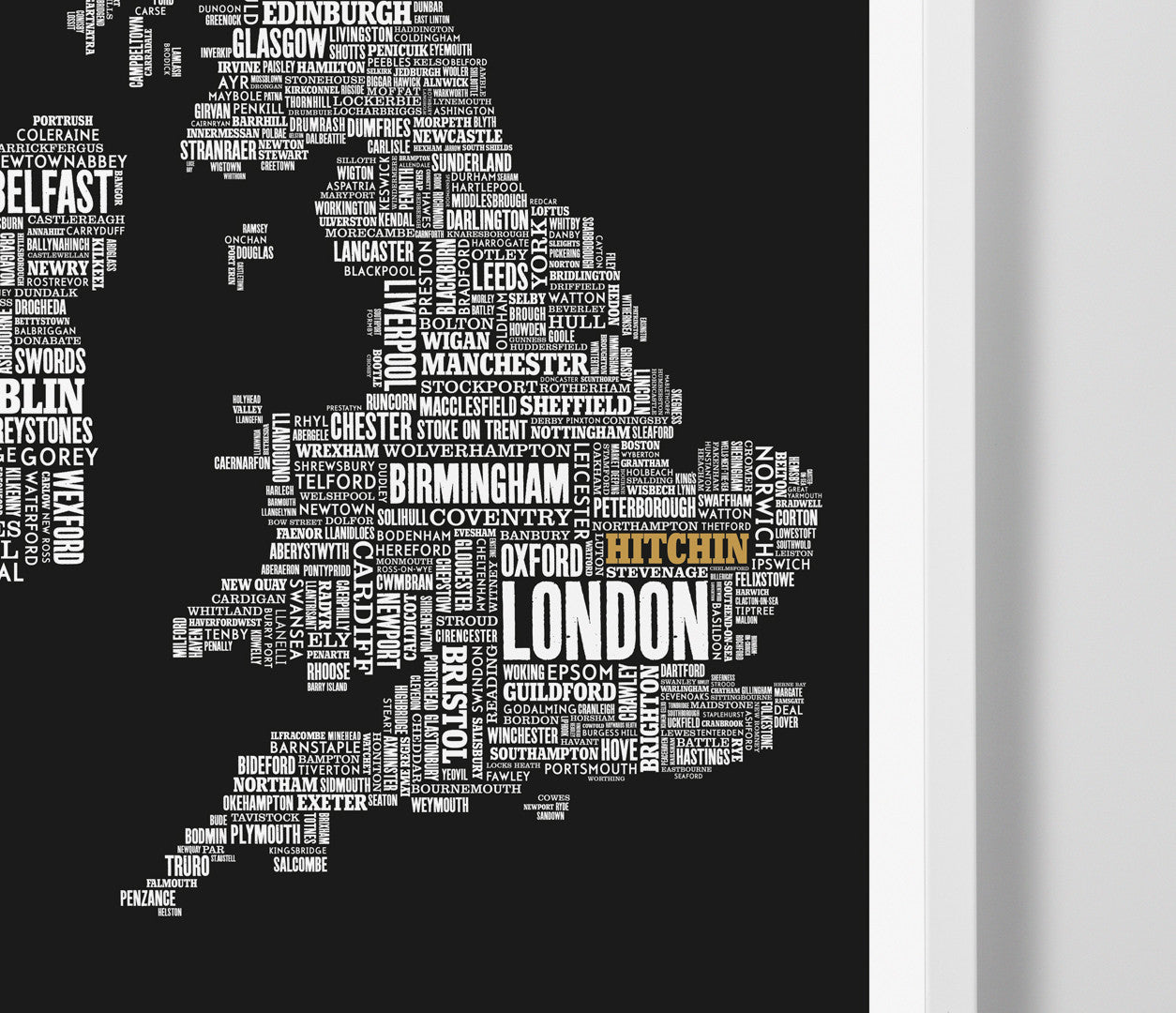 Close Up of UK Map limited edition print in black with 'Hitchin' in gold, screen printed on recycled paper, delivered worldwide