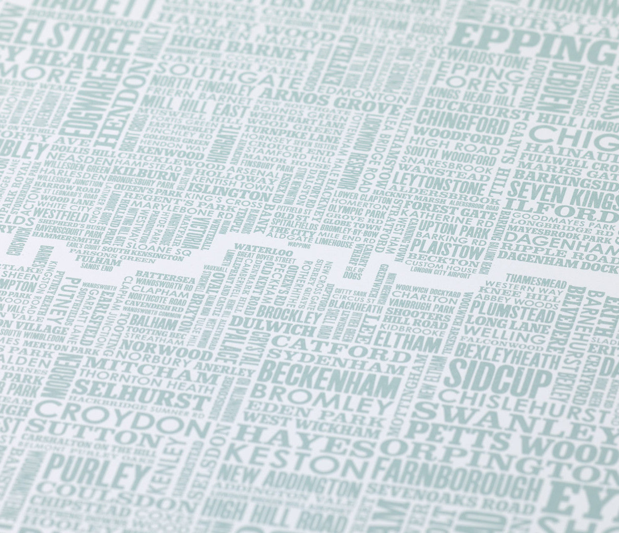 Close up of London and Beyond Type Map print in duck egg blue