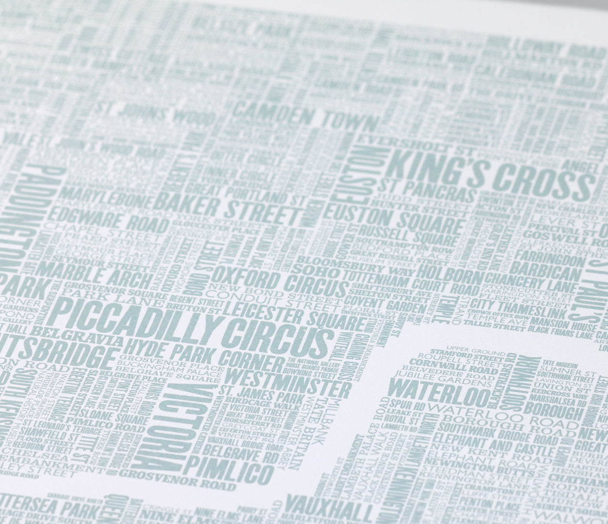 Close up of London Type Map print in duck egg blue