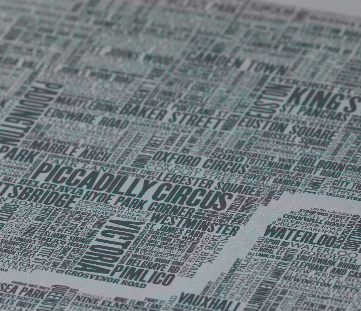 Close up of London Type Map Limited Edition Print on grey card