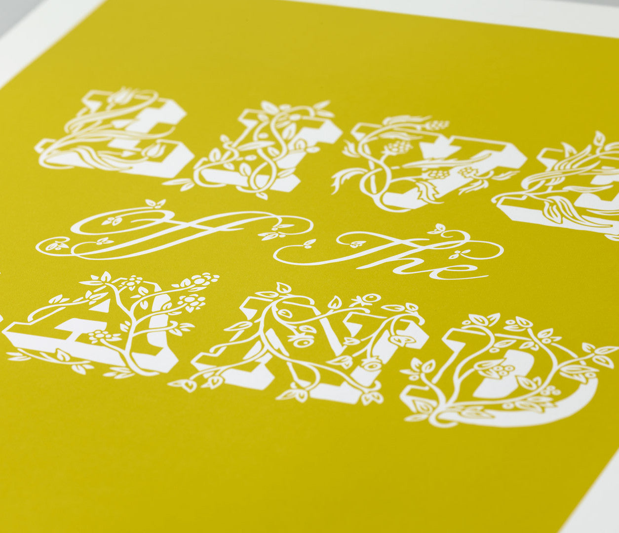 Close up of Live off the Land print in yellow moss