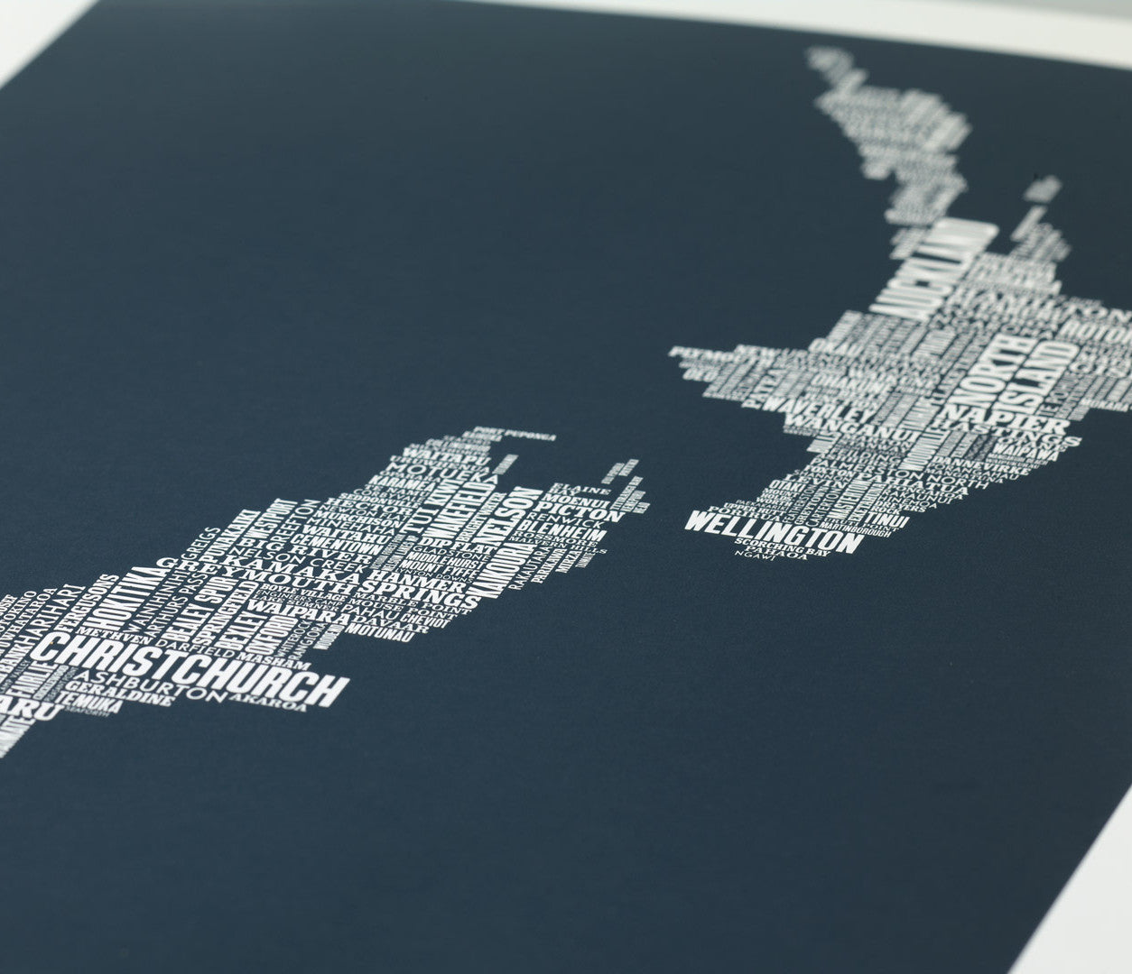 Close Up of New Zealand Type Map Print in sheer slate