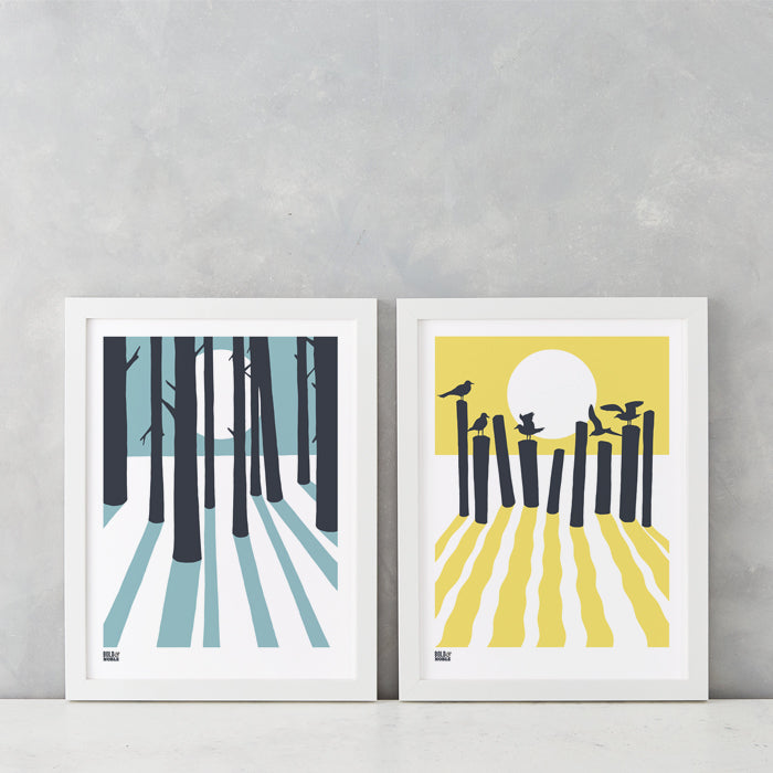 Sunrise and moonlight beach and woods wall art prints in coastal blue and pale yellow, delivered worldwide