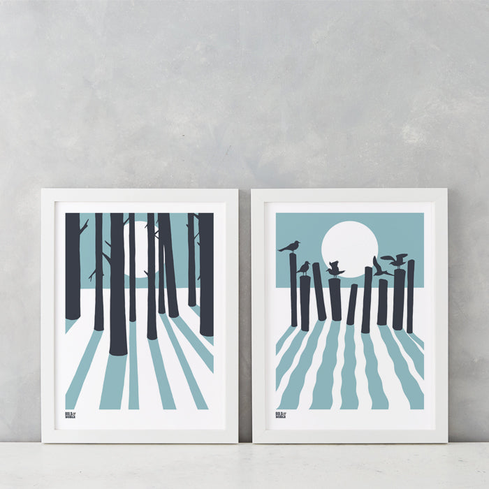 Sunrise and moonlight beach and woods wall art prints in coastal blue and slate grey, delivered worldwide