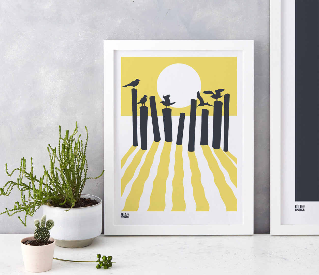 On the beach, sunset silhouette screen print in pale yellow and dark grey, hand screen printed in the UK