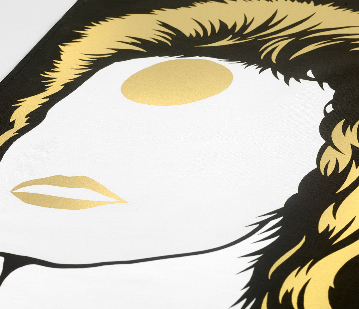 Close up of David Bowie screen printed Tea Towel in bronze