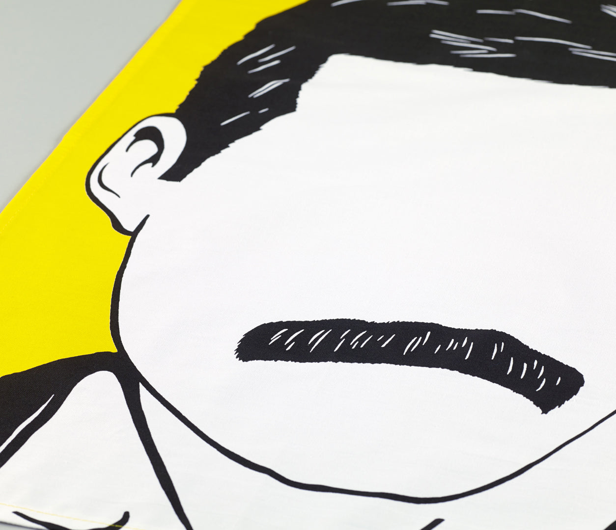 Close of Freddie Mercury tea towel, screen printed in the UK