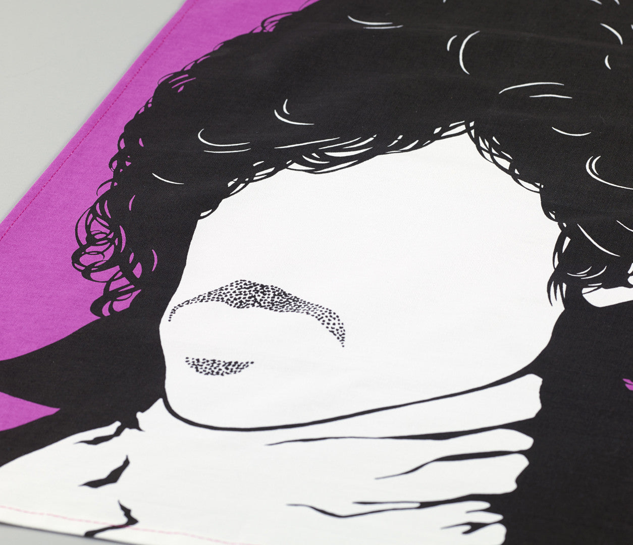 Close up of Prince Rock Icon Tea Towel in Purple
