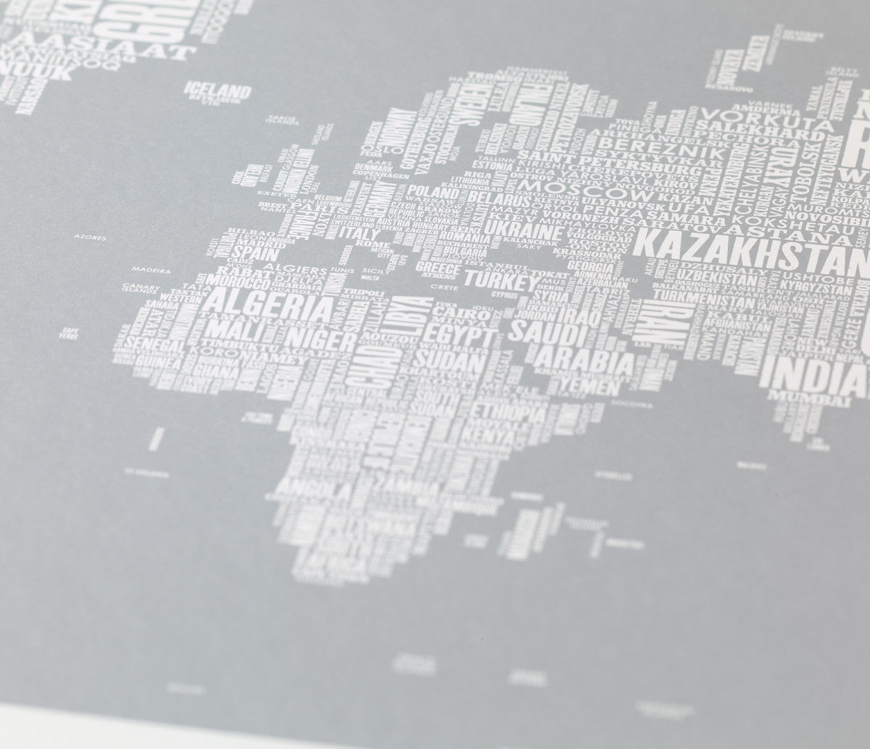 Close up of Wordle Type Map of the World in Gold