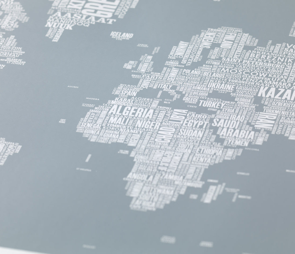 Close up of Wordle Type Map of the World in Grey