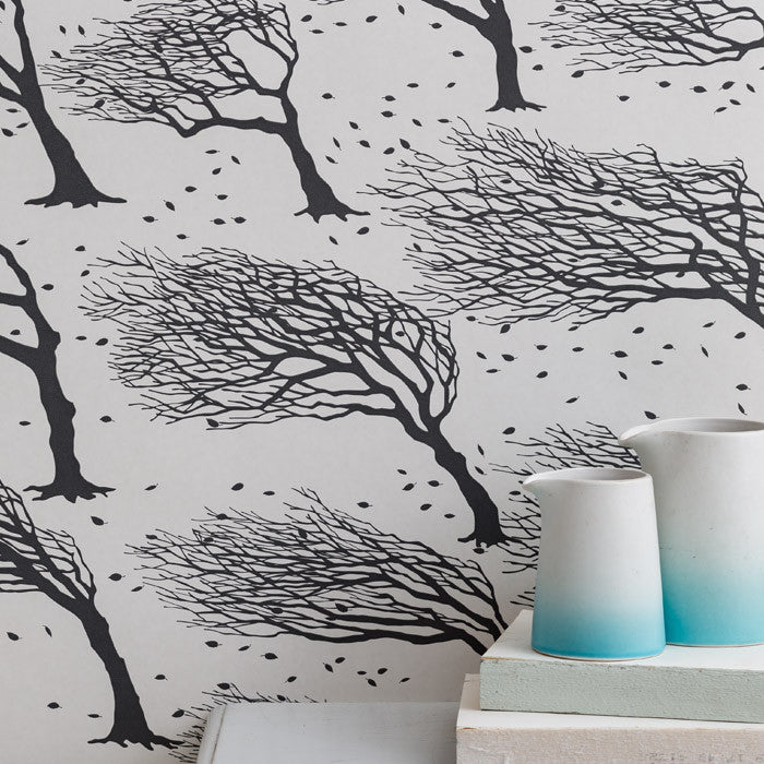 Northeasterly Windswept Trees Wallpaper in Dark Grey, printed in the UK, deliver worldwide
