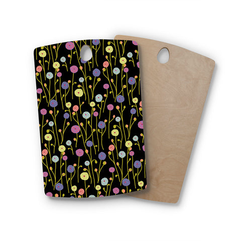 "Laura Nicholson ""Ranunculas On Black"" Yellow Floral Rectangle Wooden Cutting Board"